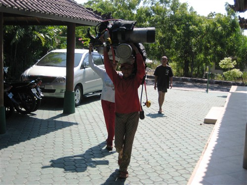 070 Women carry two scuba tanks on their heads.jpg