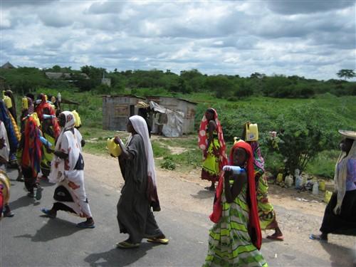 118 Women selling juice to passing buses.jpg